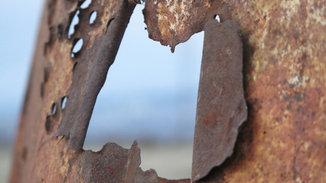 Close up rusted metal with holes